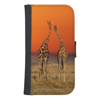 A Giraffe couple walks into the sunset, in Samsung S4 Wallet Case