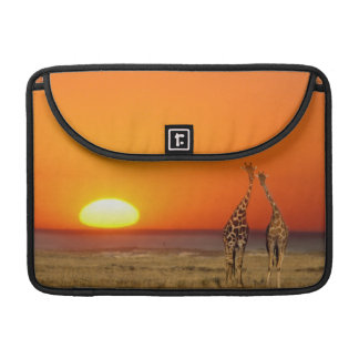 A Giraffe couple walks into the sunset, in Sleeve For MacBook Pro