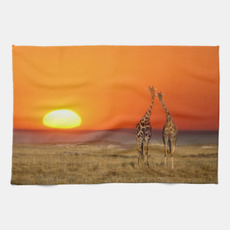 A Giraffe couple walks into the sunset, in Tea Towel