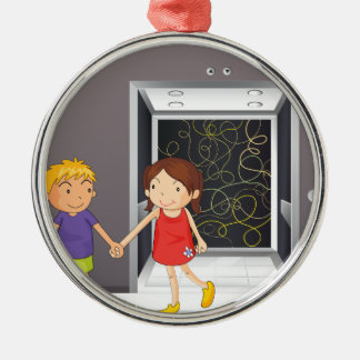 A girl and a boy holding hands near the elevator christmas ornament