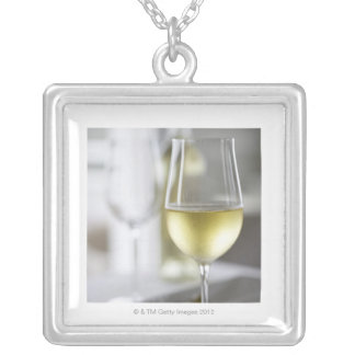A glass of white wine 2 silver plated necklace