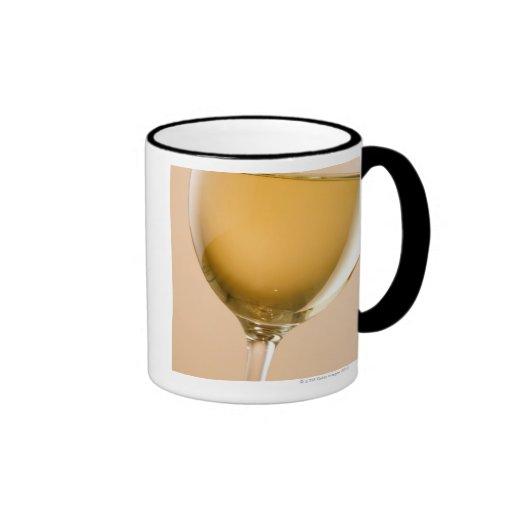 A glass of white wine mugs