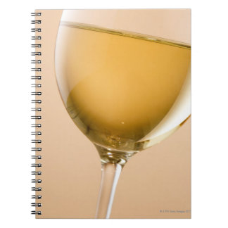 A glass of white wine notebooks