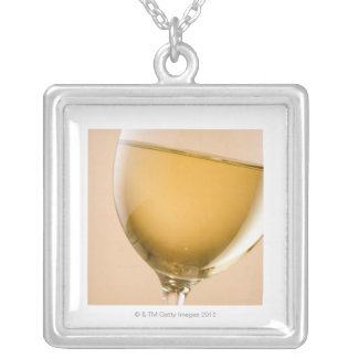 A glass of white wine square pendant necklace