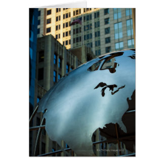 A globe with a stainless steel North America Card