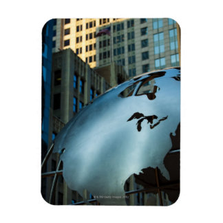 A globe with a stainless steel North America Rectangular Photo Magnet