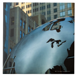 A globe with a stainless steel North America Tile