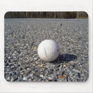 A golf Ball resting on gravel Mousepads