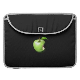 A green apple on MacBook sleeve