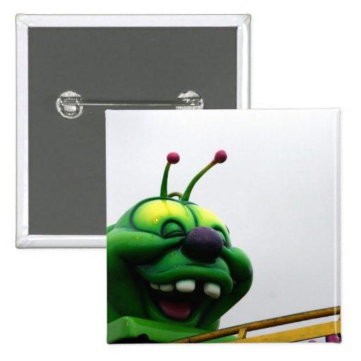 A green caterpillar goofy fair ride image 15 cm square badge