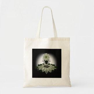 A Green Flower on Black Background Tote Bag
