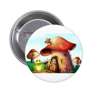 A green frog near a mushroom house 6 cm round badge