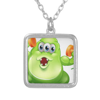 A greenslime monster with orange dumbbells square pendant necklace