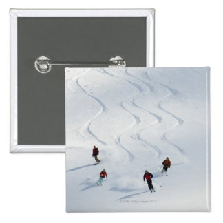 A group of backcountry skiers follow their guide 15 cm square badge