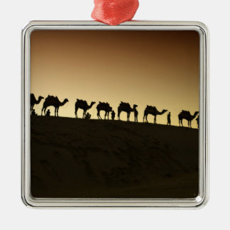 A group of camel herders with their camels at christmas tree ornament