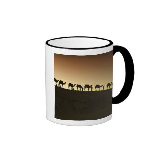 A group of camel herders with their camels at mug