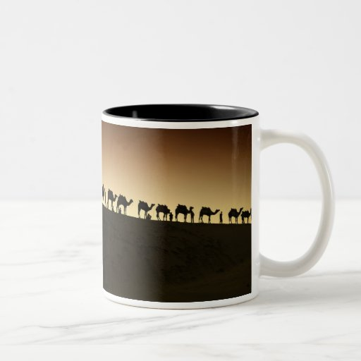 A group of camel herders with their camels at coffee mugs