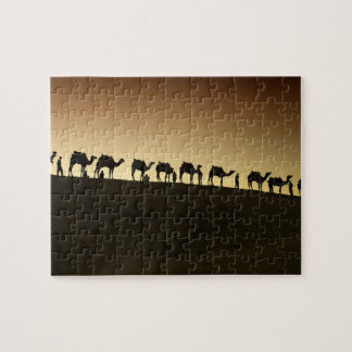 A group of camel herders with their camels at jigsaw puzzle