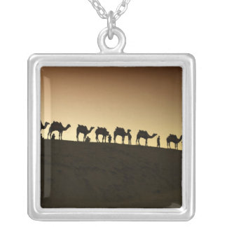 A group of camel herders with their camels at silver plated necklace
