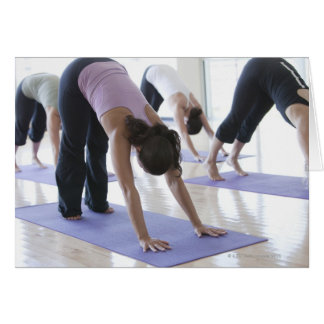 a group of women practicing yoga in a bright greeting card