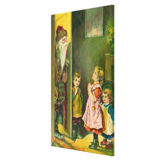 A Happy Christmas Kids Letting Santa In Stretched Canvas Prints