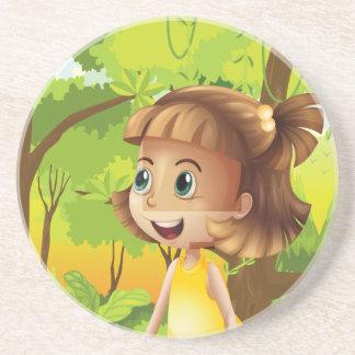 A happy girl near the trees coasters