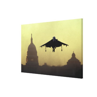 A Harrier jet landing on the Mall at dawn with Canvas Print