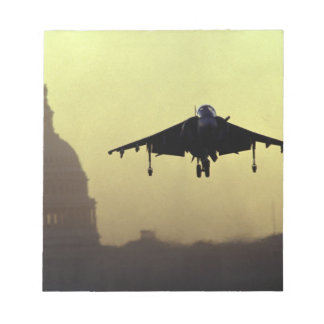 A Harrier jet landing on the Mall at dawn with Notepad
