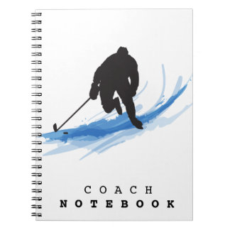 A Hockey Player on ice Note Books