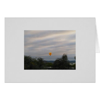 A hot-air balloon against a stormy sky card