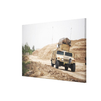 A Humvee conducts security Gallery Wrap Canvas
