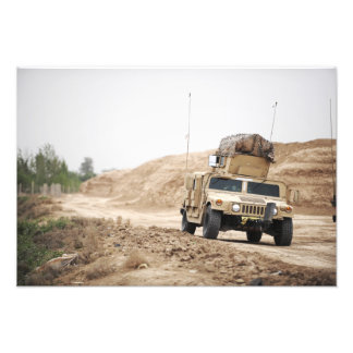 A Humvee conducts security Photo Print