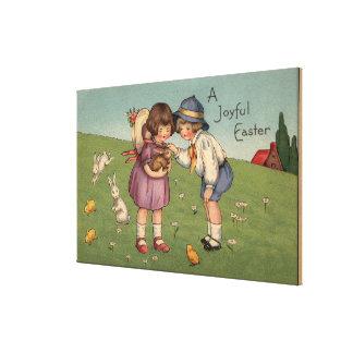 A Joyful EasterKids Holding a Bunny Canvas Print