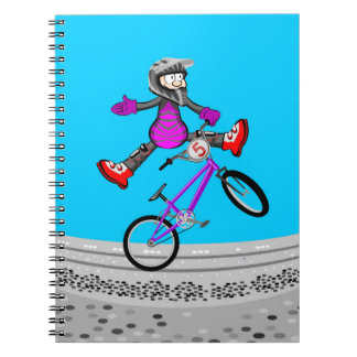 A jump of extreme acrobatics in bicycle BMX Spiral Notebook