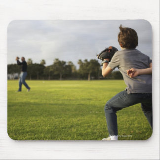 A kid wearing a baseball glove waits for his dad mouse pad