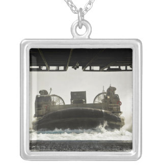 A landing craft air cushion prepares to enter square pendant necklace