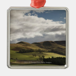 A Landscape With Rolling Hills And Clouds Overhead Christmas Ornament