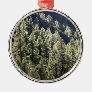 A larch forest in autumn Silver-Colored round decoration