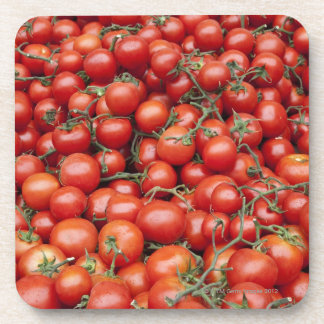 A large crop of tomato on a market stall in coaster