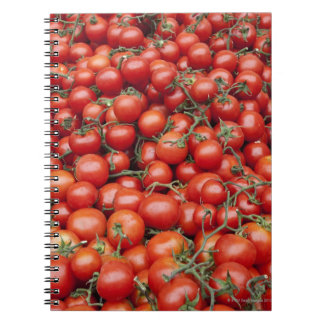 A large crop of tomato on a market stall in notebooks