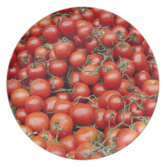 A large crop of tomato on a market stall in plate