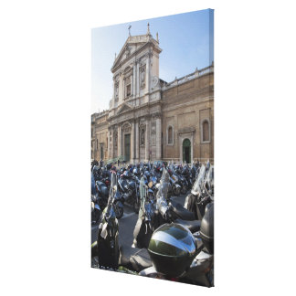 a large number of motor scooters parked near a gallery wrapped canvas