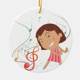 A little girl dancing with musical notes round ceramic decoration