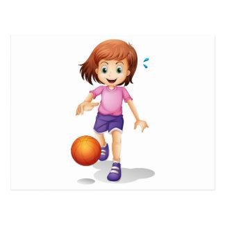 A little girl playing basketball postcard