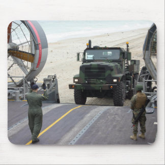 A loadmaster guides a Marine 7-ton truck Mouse Pad