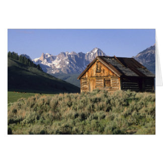 A log cabin and the Sawtooth Mountains in Card