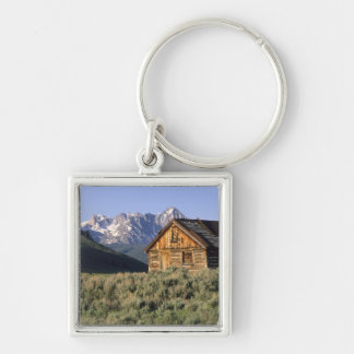 A log cabin and the Sawtooth Mountains in Key Ring