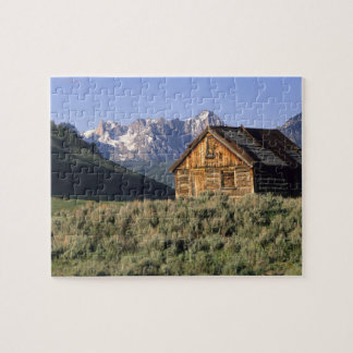 A log cabin and the Sawtooth Mountains in Puzzle