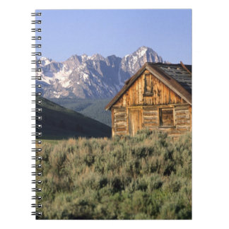 A log cabin and the Sawtooth Mountains in Spiral Notebook