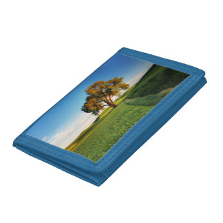 A lone tree surrounded by rolling hills of wheat tri-fold wallets